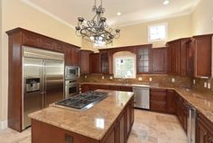Traditional Kitchen with stone tile floors, can lights, Pental - Crema Bordeaux Select Polished Granite, Casement, dishwasher
