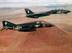 F-4 & F-14. The last F-14 built (1997) is on display at NAS Oceana. It came to us painted just like this one !!