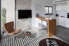 עיצוב מינימליסטי על השדרה | בניין ודיור