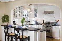 Shaker-style cabinets, soapstone countertops, farmhouse sink, U-shaped kitchen, small kitchen