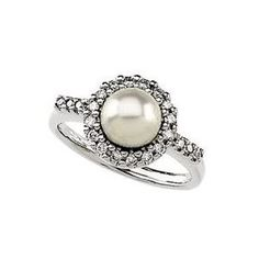 I think I would almost rather have a pearl than a diamond.... Pearls are so pretty and classic looking..