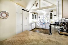 Open concept, up-scale kitchen with vaulted ceiling.