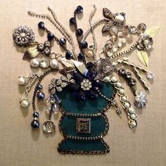 One of a kind floral picture .....made with bits and pieces of jewelry...by Brenda Henning