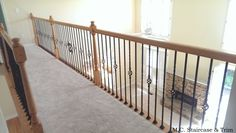 After the iron baluster upgrade from M.C. Staircase & Trim. Removal of wooden baluster and installation of Single Twists, Single Baskets with an accenting Nautilus Scroll in Satin Black.