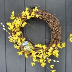 turning dollar store finds into a spring wreath, crafts, seasonal holiday decor, wreaths, Some fake pussy willows also from the dollar store add more interest to the forsythia