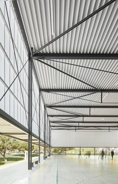 Image 5 of 16 from gallery of Municipal Sports Pavilion of Vila-Seca / NAM Arquitectura. Photograph by José Hevia Cultural Architecture, Factory Architecture, Romanesque Architecture, Pavilion Architecture, Industrial Architecture, Education Architecture, Classic Architecture, Residential Architecture, Contemporary Architecture