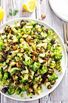 This roasted broccoli salad has both roasted and raw broccoli, toasted almonds, cranberries and tiny pieces of tart lemon. It