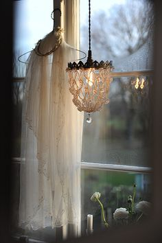 I believe I'll copy this and bring my wedding veil down and hang it someplace I can enjoy it, even if it fades or discolors, won't matter. I'll never sell it. :)