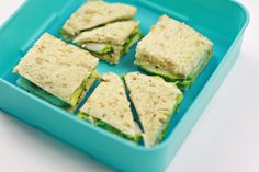Avocado and Cucumber Sandwich | This unassuming sandwich is fun when cut into small shapes. You can also use cookie cutters for more variety. Just two pieces of wheat bread sprinkled with salt and pepper layered with thin avocado slices that have been squeezed with lime juice and then topped with a layer of cucumbers. Crunchy, creamy, delightful.