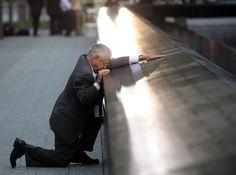Pulitzer Prize Winning Photo of man at the  ground zero memorial of the 911 terrorist attack.
