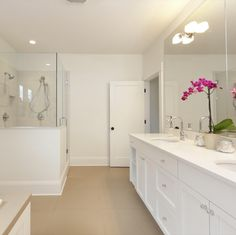 Clean Bathroom With Double Sinks And Large Mirror