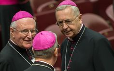 Polish bishops vow to resist change at synod on the family Archbishop Stanislaw Gadecki of Poznan, Poland, right, speaking with Archbishop Denis Hart of Melbourne at last year's synod on the family (CNS)