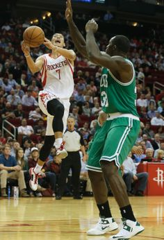 HOUSTON, TX - NOVEMBER 19: Jeremy Lin #7 of the Houston Rockets goes up for a shot over Brandon Bass #30 of the Boston Celtics at the Toyota Center on November 19, 2013 in Houston, Texas. (Photo by Scott Halleran/Getty Images)