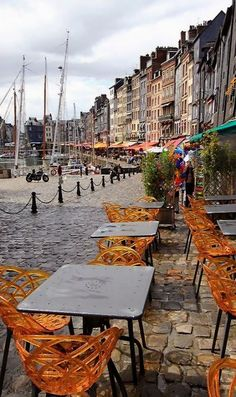 ~Honfleur, Normandy, France~ I've been here and these chairs are so cool, they're bright orange color
