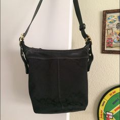 Coach Black C print bucket crossbody bag Zipper Closure. Large crossbody bag and the strap has gold-plated detail. Black. Has multiple pockets inside. Barely used. Coach Bags Crossbody Bags