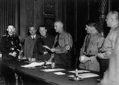German Nazi leaders at a conference, (left to right, uniformed);Heinrich…