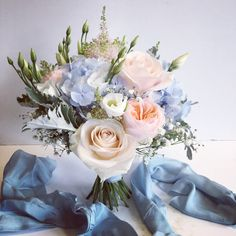 Pink peach and blue Bridesmaid bouquet including Hydrangea and Roses. Designed and created by The Floral Design Boutique, Scotland.