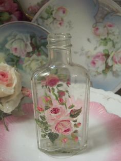Pretty bottle and china.
