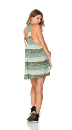 The Daytripper Dress by RVCA has a sexy open back and armhole detail