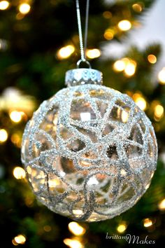 Doodle on glass ornament with glue. Pour glitter over ornament, tap extra glitter off. Let dry.