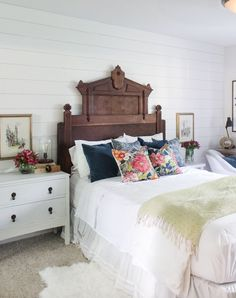 Antique Bed With White Linens And Patterned Pillows