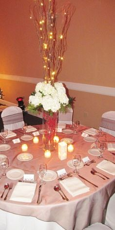 Tall reception centerpiece with lighted branches