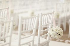 white wedding chairs with hanging white pomanders (photo: Simply Bloom / via Bride's Cafe) #white #wedding #chairs