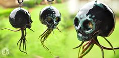 """Ceramic skull """"air plant"""" hanger (Okay... hang some of these on your porch... ain't no one comin around to visit or solicit... not even the in-laws/out-laws... - Deb)"""