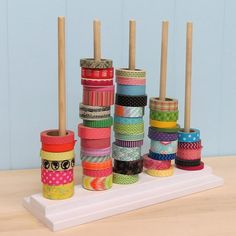 """Here's a stylish and simple way to organizer all of those washi or ribbon spools! Five 3/8"""" dowels are spaced evenly apart and removable. So, if you're storing washi tape, all five dowels are a perfec"""