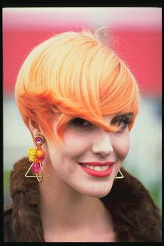 short candy orange hair via Hair Color Ideas - I like the color not sure about the style