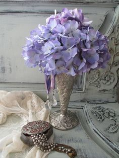 Wonderful purple flower arrangement perfect for tea parties...