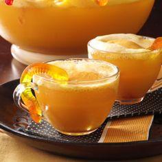 WORMY ORANGE PUNCH 1 gallon orange sherbet, softened      1 quarts pineapple juice, chilled      1 liter lemon-lime soda,  chilled Gummy worms