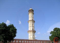 Isar Lat was built by Sawai Ishwari Singh in 1749 AD. Saragasuli is a seven storey 60 feet high ocatagonal tower, which offers breathtaking 360 degree views of old jaipur city from its top storey. It is located near the tripoliya gate of city palace in Aathish market. Our Town, Jaipur, Cn Tower, Palace, Gate, This Is Us, Places To Visit, Architecture, Building