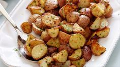 Garlic Roasted Potatoes Recipe : Ina Garten : Food Network  Place baking sheet into oven while warming to temp. Used russet potatoes, quartered. Try garlic powder next time, minced garlic burned. Only baked for 30 minutes, flip potatoes at 15 minutes. Broil if not crisp enough.