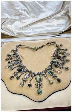 A rare and exquisite antique cat's eye and diamond necklace. Featuring sapphires, chrysoberyl, emeralds, and alexandrite. At Jogani.