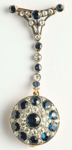 Watch Brooch with Diamonds and Sapphires. The First Half of the 20th Century, Mounted in Yellow Gold. The Small Clock is Signed Mido.