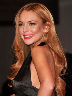 Coral red on Lindsay Lohan. She looks good—someone pinch me!