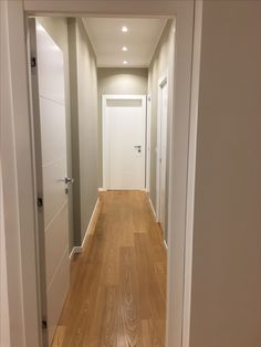 Hallway parquet white doors garofoli miraquadra
