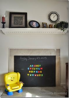 DIY Magnetic Chalkboard Fireplace Cover