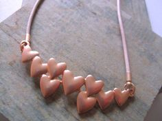 Rose Gold Hearts On Pink Leather Necklace