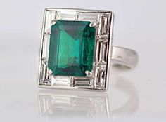 6.25 Carat Emerald Cut Emerald and Diamond  Platinum Ring | From a unique collection of vintage fashion rings at https://www.1stdibs.com/jewelry/rings/fashion-rings/