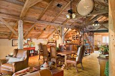Texas Transplant: Barn Loft Apartment | An abbreviated second floor holds the kitchen, bedroom, and living space. Pine floorboards went down with porch screws hidden under dowels for a pegged look; layered walnut and oak stains highlight the dips and knots and give the floor an aged patina. | Photo: Bill Matthews