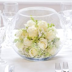 Fish bowl and roses! Great low center piece when you want to be able to see all your guests around the table.