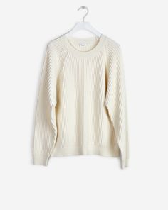 Cosy, slightly loose rib-knit pullover in a wool/cotton blend. Contrasting stitching details at raglan sleeve, narrower rib-knit at cuff and hem. <br> <br> •More sustainable materials <br> •Hip-length <br> •Slightly loose fit <br>