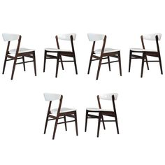 Danish Rosewood Dining Chairs in White Leather | From a unique collection of antique and modern dining room chairs at https://www.1stdibs.com/furniture/seating/dining-room-chairs/