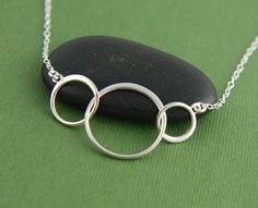 Sterling silver linked bubbles infinity by jersey608jewelry, $28.00