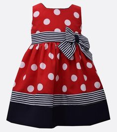 Nautical inspired sleeveless dot dress with coordinating stripes and bow detail at waist. Bonnie Jean girls dress. Free express shipping in U.S.