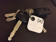 Trying out @TheTileApp, a cool little Bluetooth receiver customized with our @Ayzenberg logo.