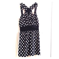 Polka Dot Tank Adorable black blouse with white polka dots. Criss-cross back detail with sequin center. Black sequin accents on straps. Candie's Tops Tank Tops