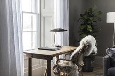 Some design elements—like sheepskin throws—nod to both Scandinavian and Scottish design.
